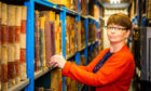 Senior archive assistant Lorna Westwater in AK Bell Library's archive 'strong room'