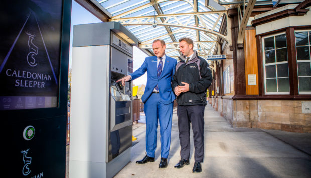 Alex Hynes, managing director of Scotrail with Conservative MP Luke Graham at the new machine.