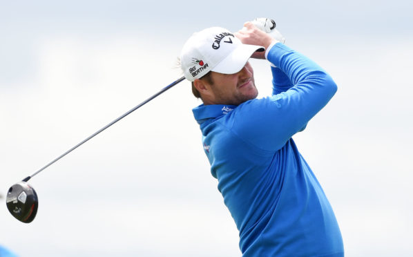 Marc Warren has regained his tour card at Q School just a couple of weeks after losing it.
