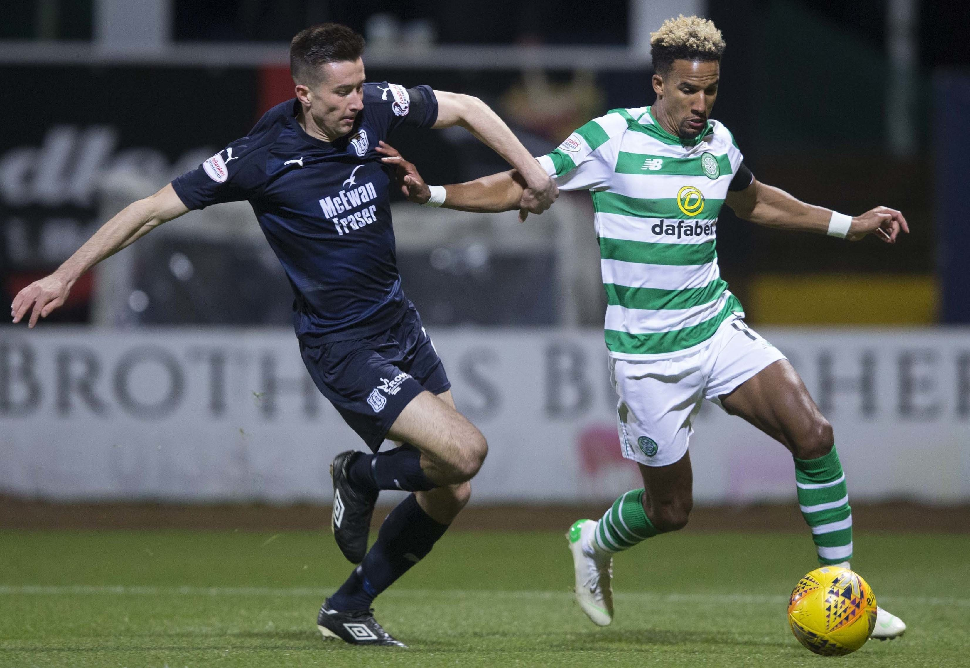 Cammy Kerr challenges Celtic winger Scott Sinclair on Wednesday night.
