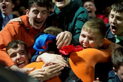 United striker Pavol Safranko is embraced by fans at full-time.