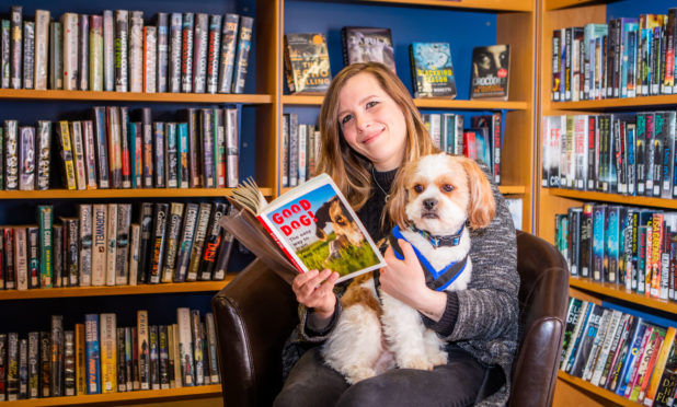 Katie McCandless-Thomas (Dog Friendly Perthshire) and Baxter (aged 4) from Perth, enjoying a quiet read in the library.