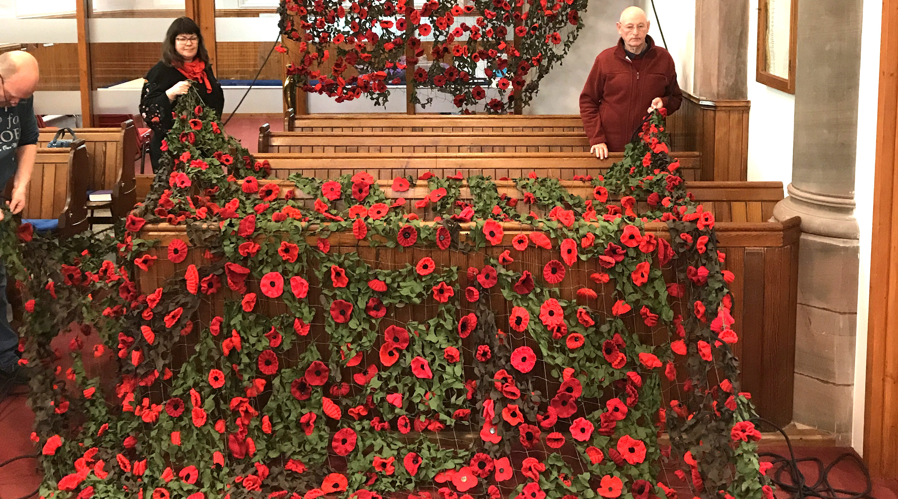 Working on the poppy display inside the Kirk