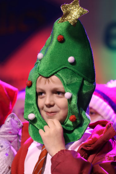 A pupil from Eastern Primary School sports a cool Christmas tree hat.