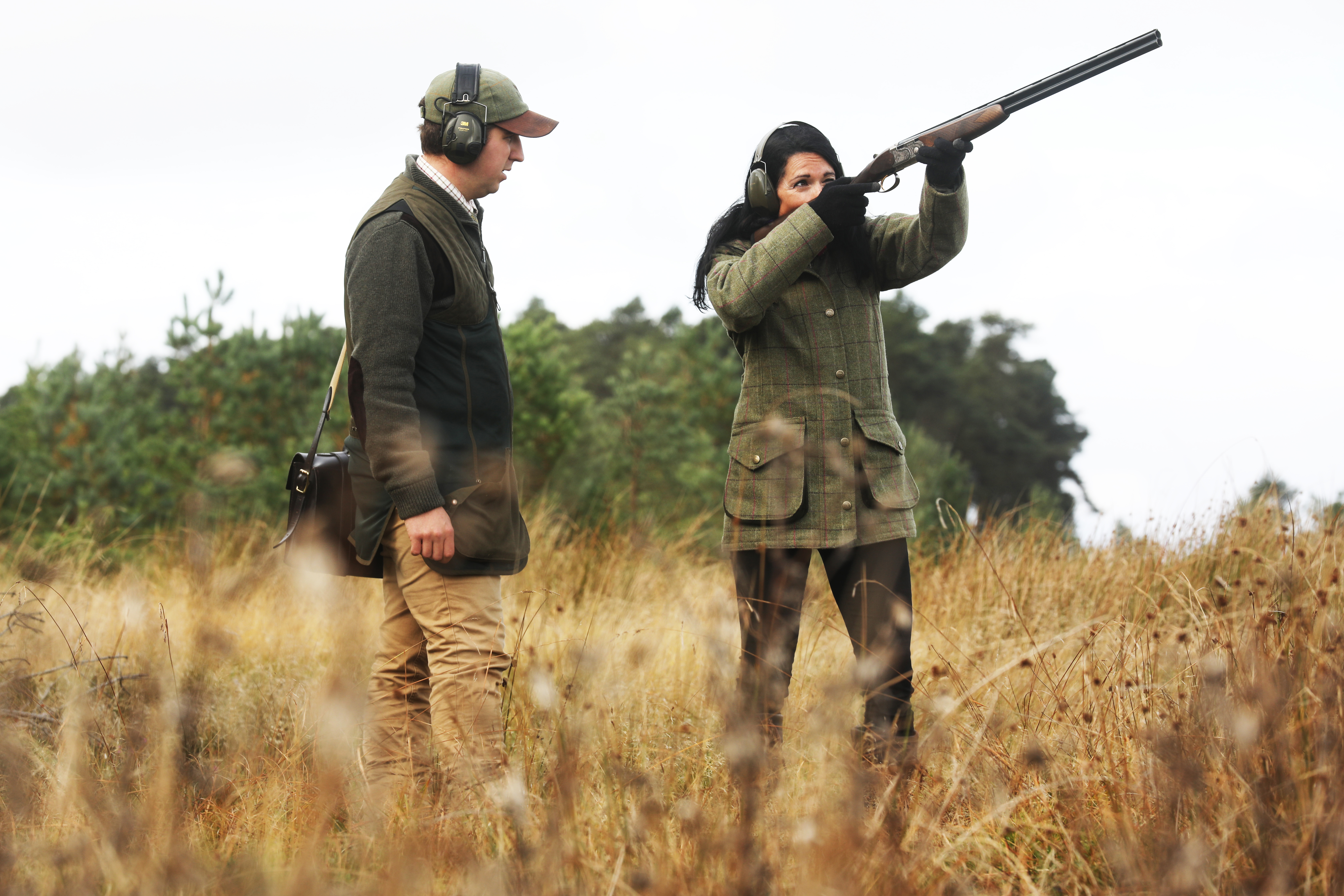 Gayle enjoys a clay target shooting lesson with David Harris at Gleneagles Shooting School.