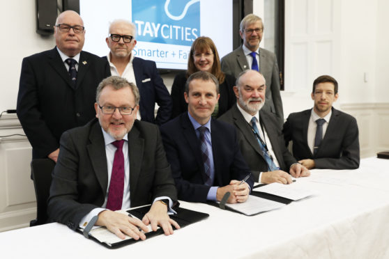 Signatories of the Tay Cities Deal in Perth in November 2018 including Angus Council leader David Fairweather (back left)