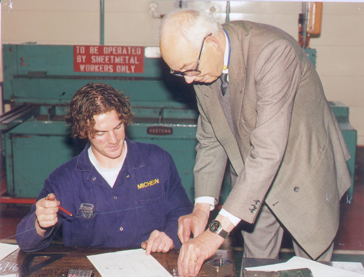 Chief executive Francois Michelin visits Dundee, and offers some help to staff, in 1997. The French businessman died in 2015.