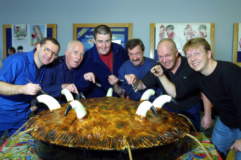 Workers at the Michelin factory in Dundee tuck into a cow pie to celebrate the firm's 30 years in the city in November 2002.