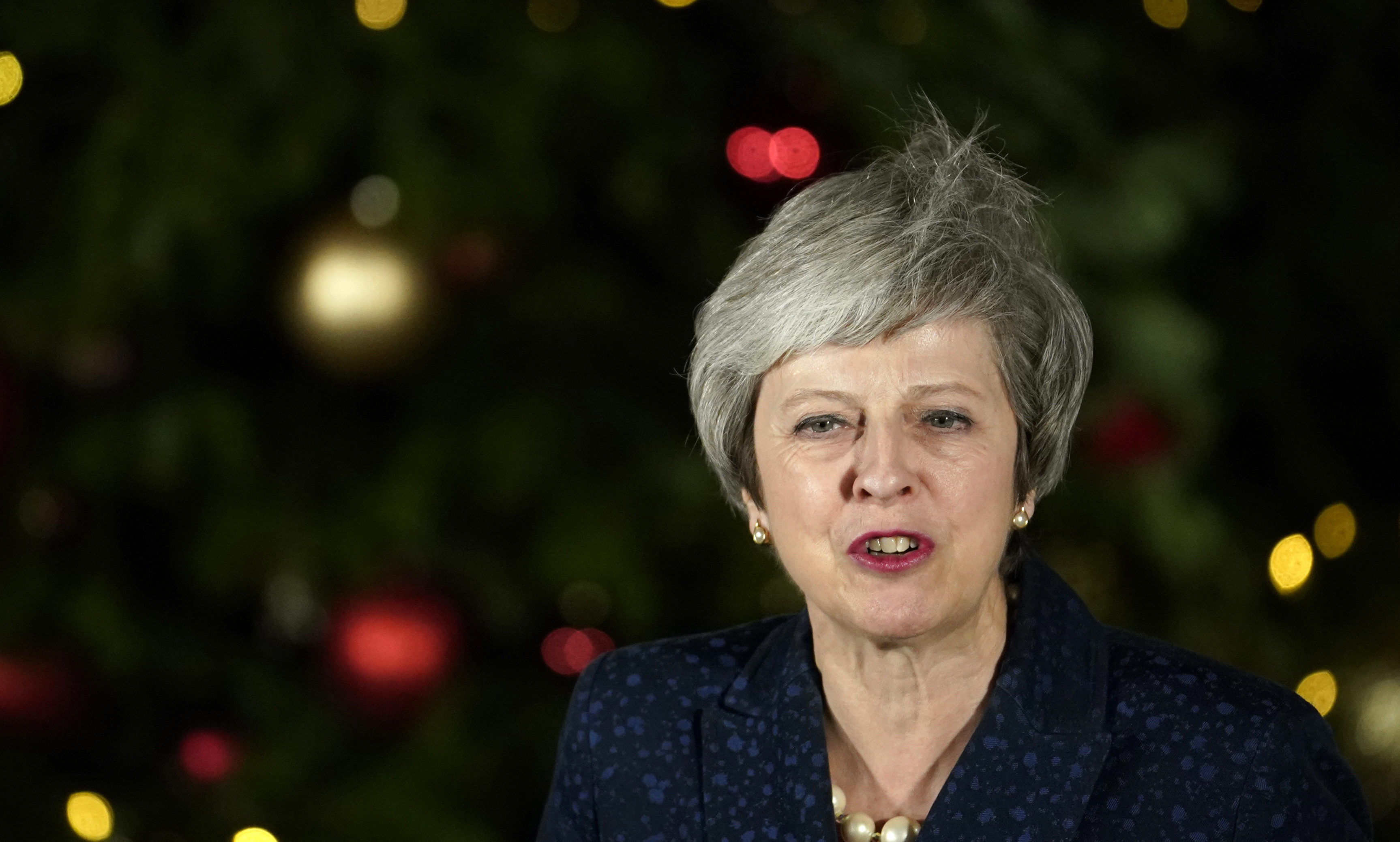 British Prime Minister Theresa May gives a speech after winning the confidence vote on December 12, 2018 in London, England.