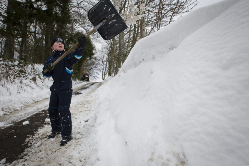 Robert Carter cleared snow leading up to his farm just outside Blairgowrie. Andrew Cawley/DCT Media