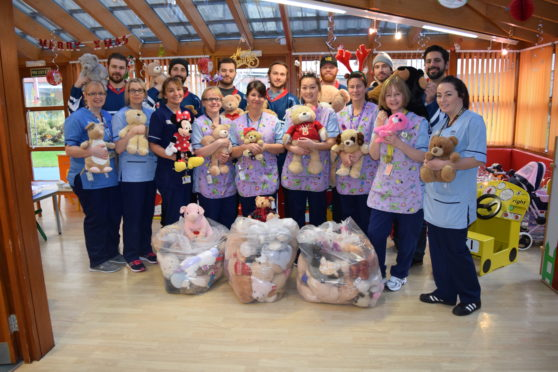 Stars players at Ninewells hospital last year donating bears which were thrown on to the ice.