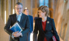 First Minister Nicola Sturgeon and Finance Secretary Derek Mackay arrive to delivering his draft Budget for 2018-19 at the Scottish Parliament in Edinburgh.