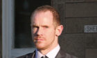 Michael Kelbie caused thousands of pounds worth of damage as he allegedly struggled with the app on his mobile phone.