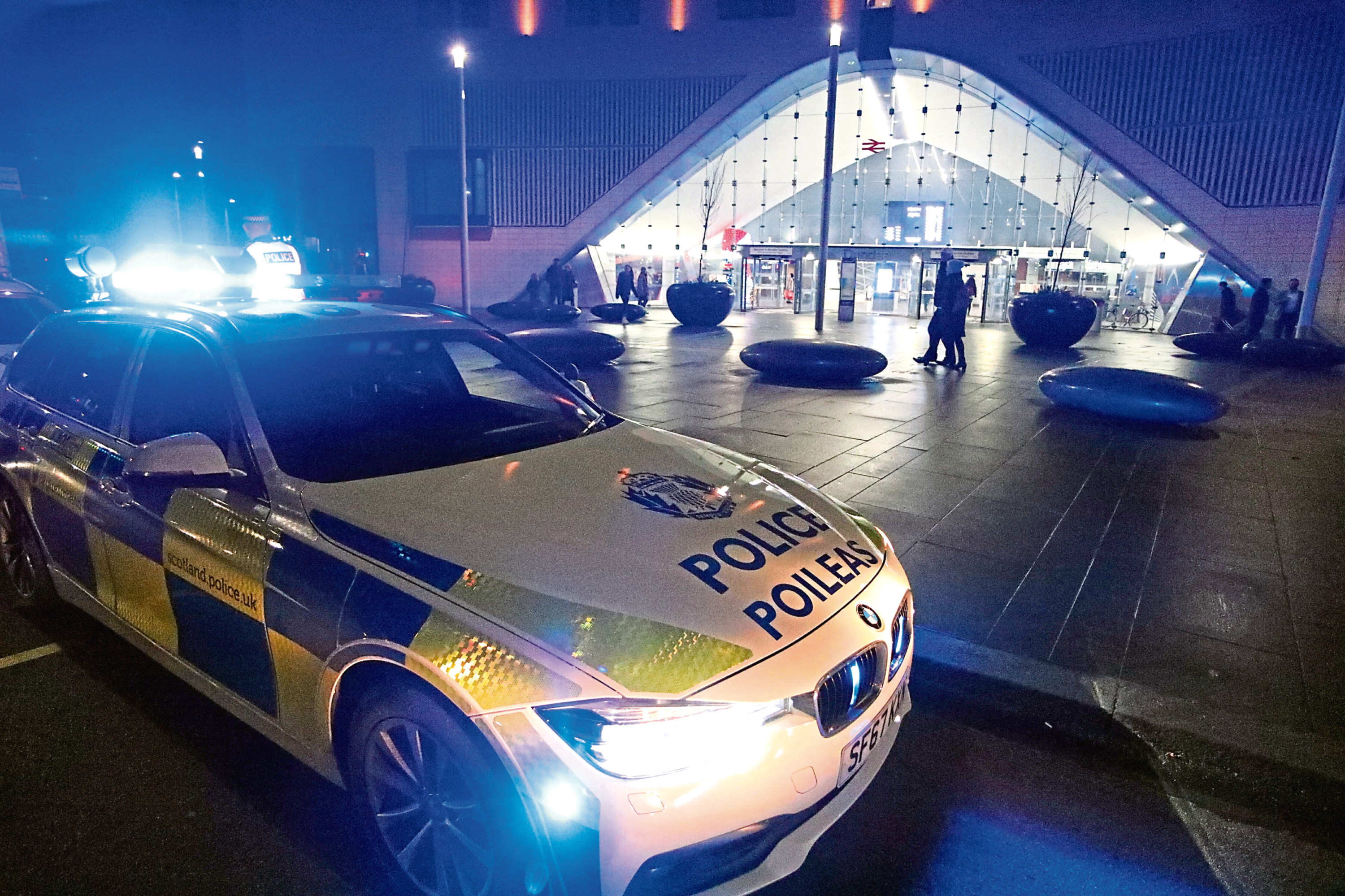 Police outside Dundee Railway Station after the fight.