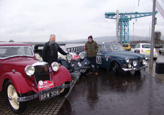 Bailie Denis Agnew of West Dunbartonshire Council (left) and UK coordinator Douglas Anderson with two classic Rileys and a Volvo Amazon at the start of theb