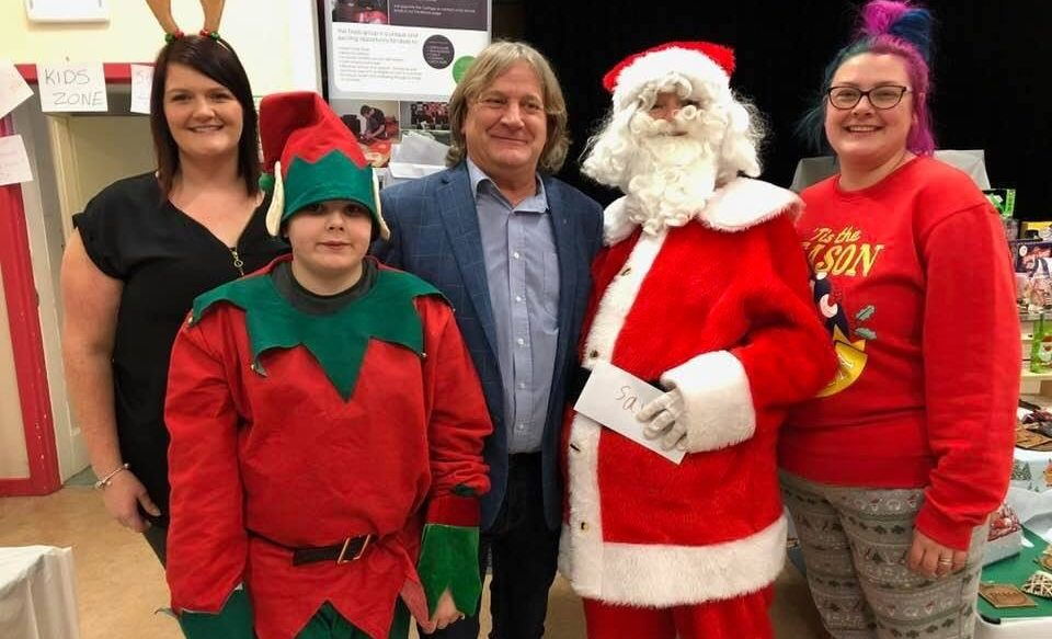 Debbie Maxwell, left, and Linzie Kerr, right, with Aidan Anderson, David Torrance MSP and Heather Bonner as Santa at Saturdays fundraising fair