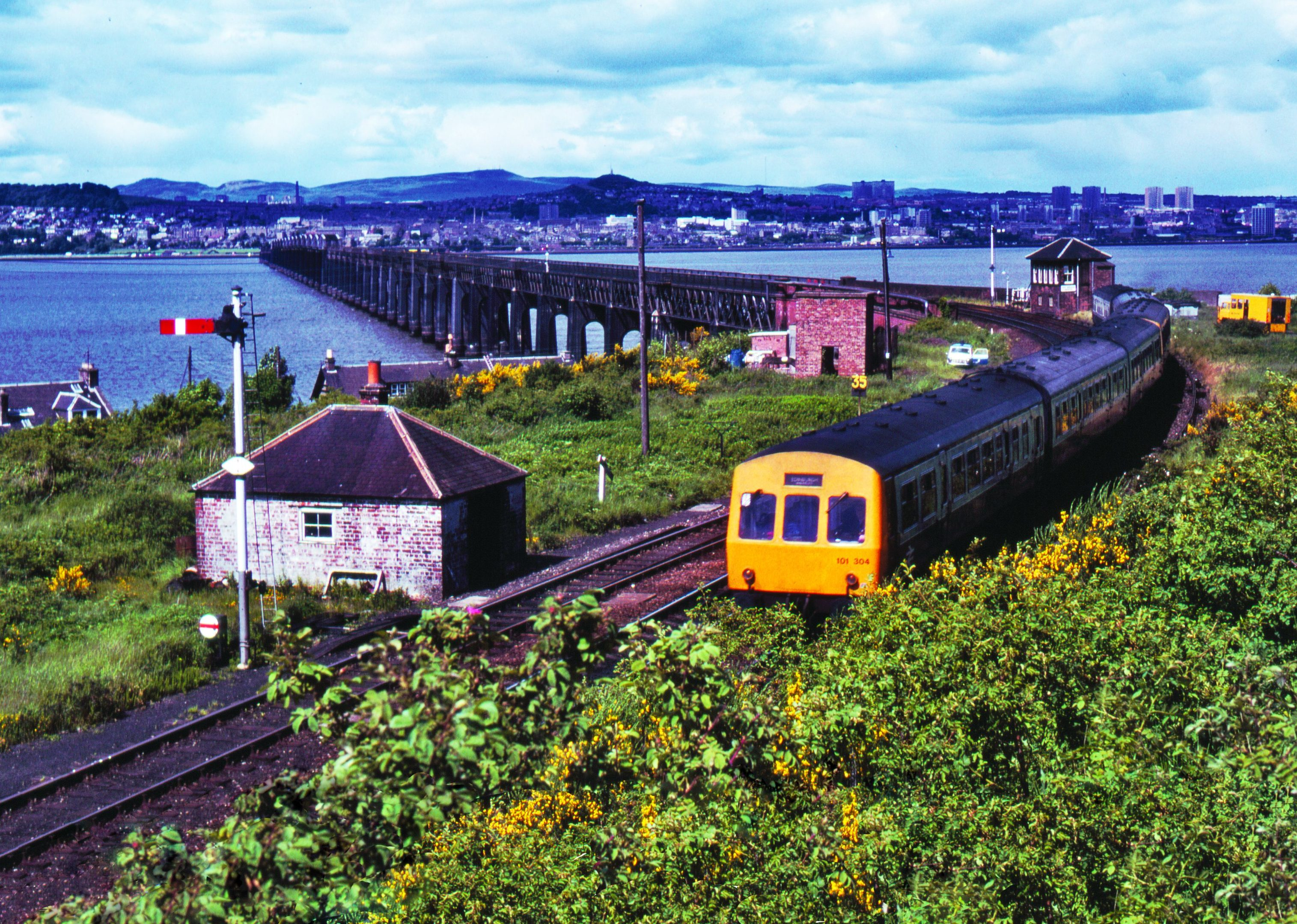 A train formed of two Class 101 units comes off the Tay Bridge at Wormit in 1981