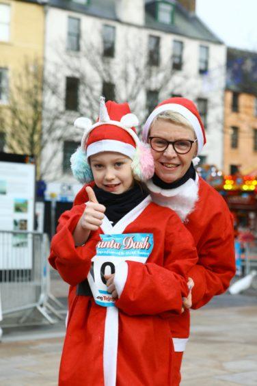 Arlene Roy with Ellie Roy at the Santa Dash.