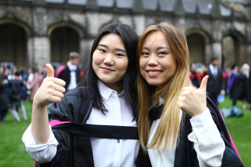 Jung Min Ko and Qiuyang Chen, both graduates in Computer Science.