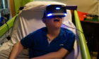 Youngster Jack tries out the VR technology at Rachel House