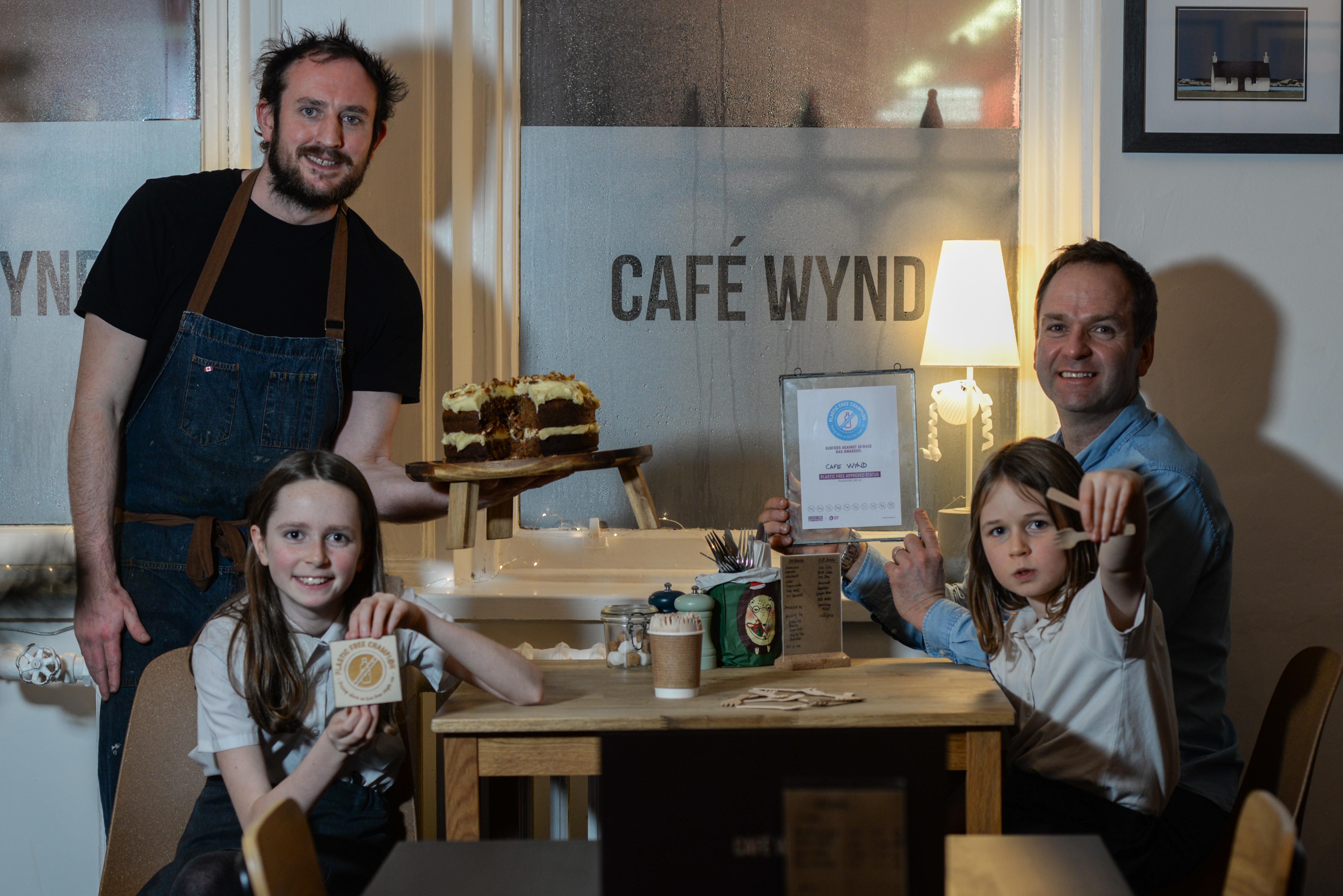 Champion award winner Stewart Forrest with Plastic-Free Dunfermline founder James Daw and Amelia and Maisie Daw.
