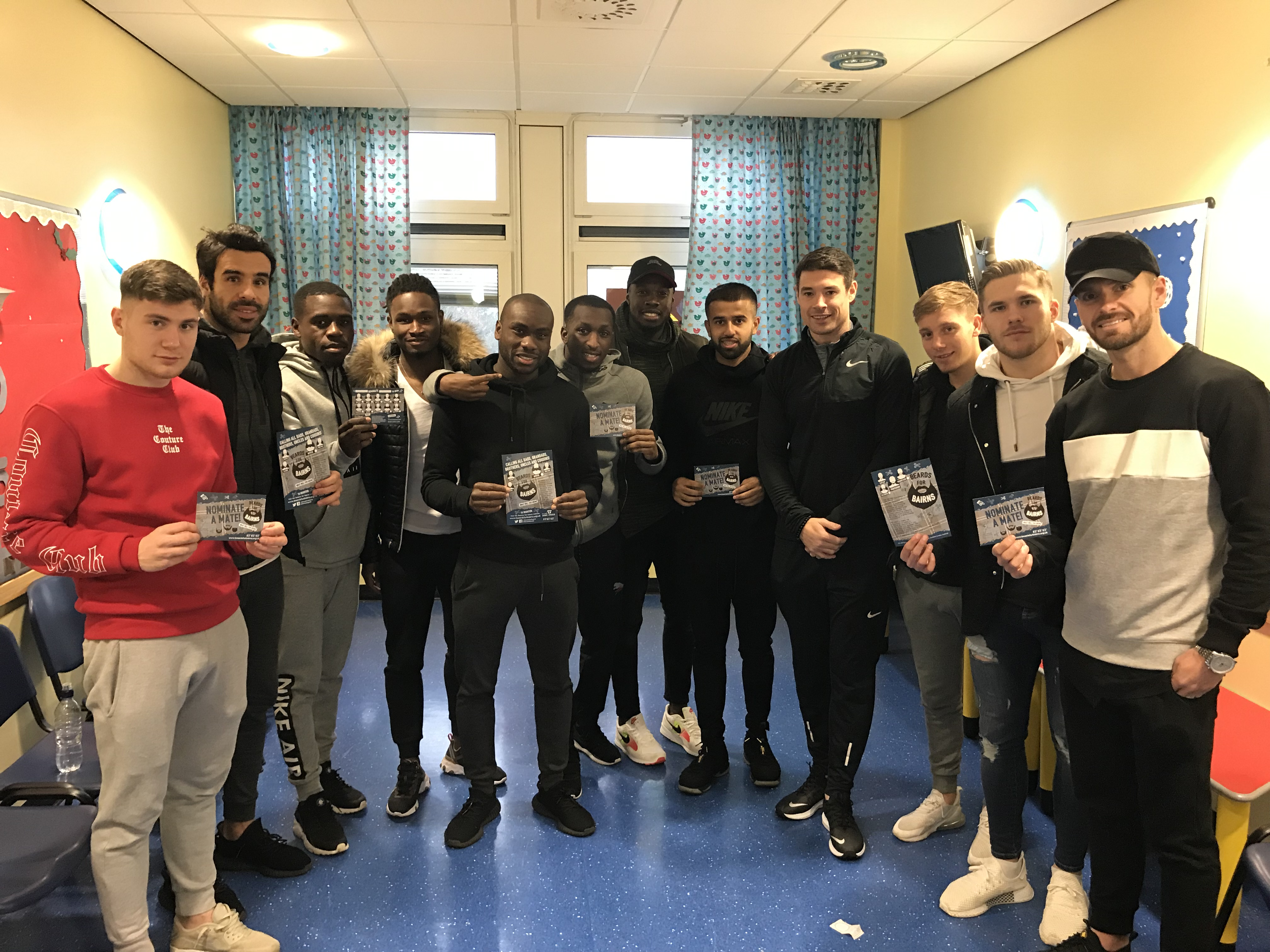 Some of the Dundee FC players at Ninewells promoting Beards for Bairns.
