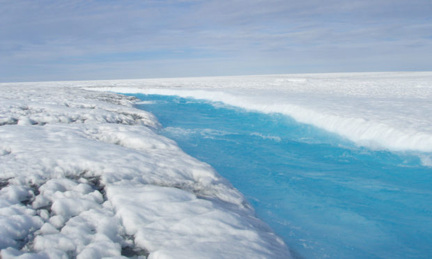 A melt stream on the Greenland ice sheet, where melting has accelerated to unprecedented rates in the face of rising temperatures, analysis of ice cores has found.