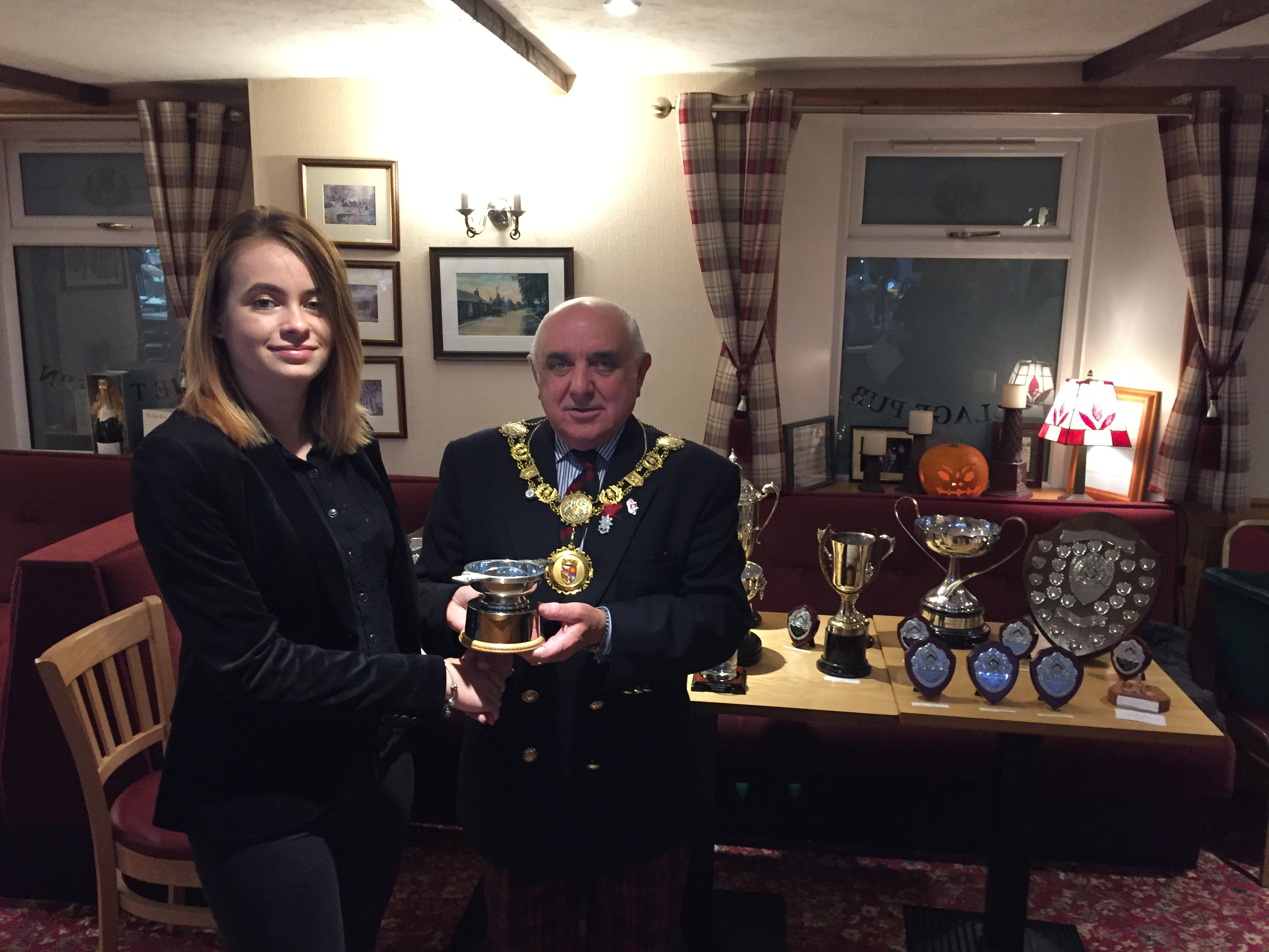 Eden receives her trophy from Angus Provost Ronnie Proctor