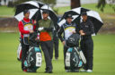 Thomas Detry (Right) and caddy Ryan McGuigan (Second from Right) with Thomas Pieters of Belgium and his caddy  talk on the 9th hole during day two of the 2018 World Cup of Golf at The Metropolitan on November 23, 2018 in Melbourne.