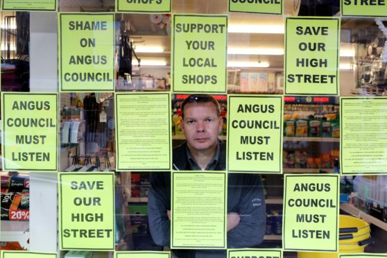Brechin hardware store owner Bruce Robertson has campaigned against the parking charges
