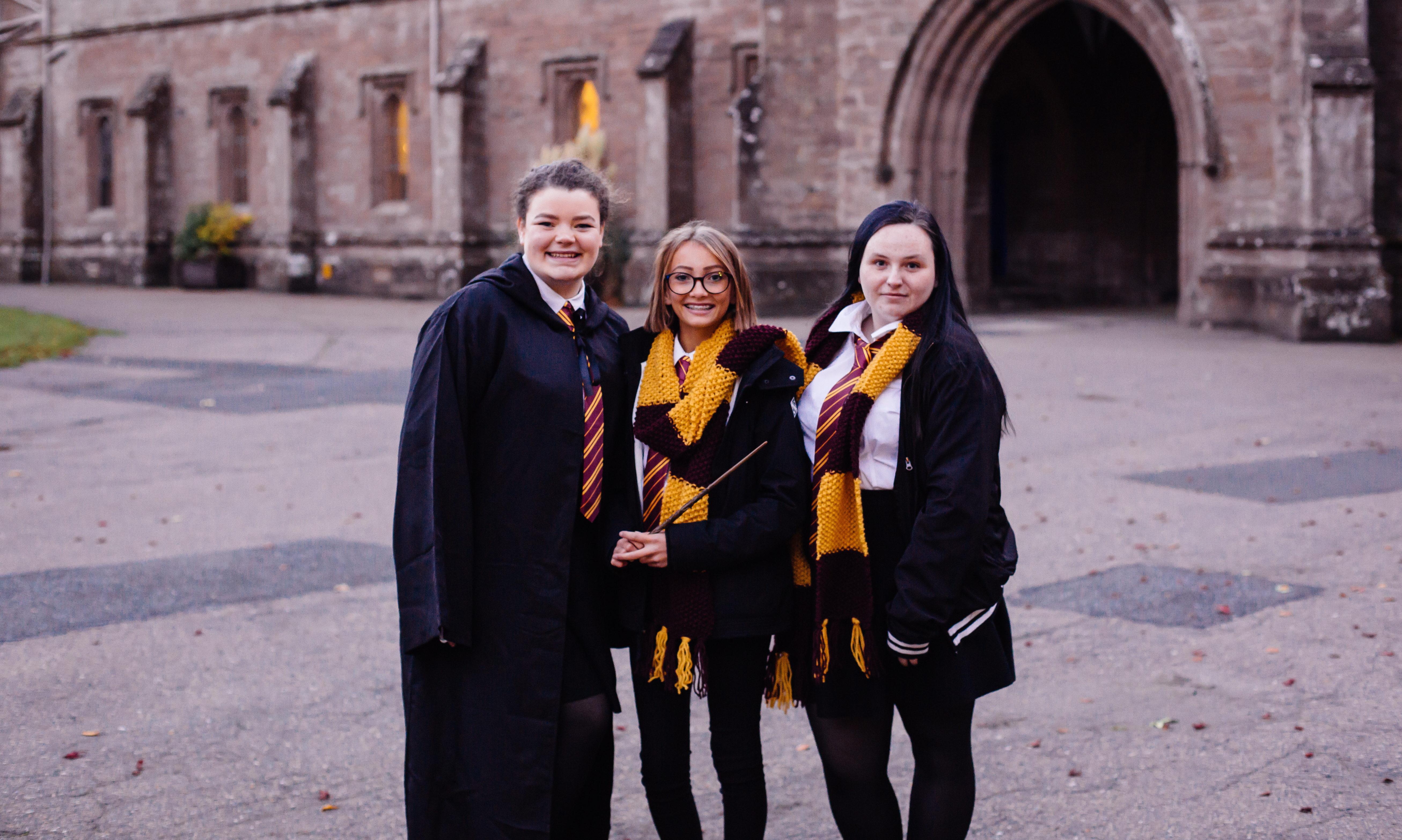 From right to left, volunteers Rhona Jack, Jodie McKenzie and Jade Delaney dressed as Hogwarts pupils