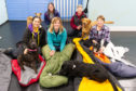Five brave volunteers and their dogs bed down at Perth pet centre. From left: Aaren Chacko with Raisin, Claire Downie with Kipper, Elaine MacFarlane with Oran, Judy Heyes with Reiver and Jan Stewart with Jasmine.