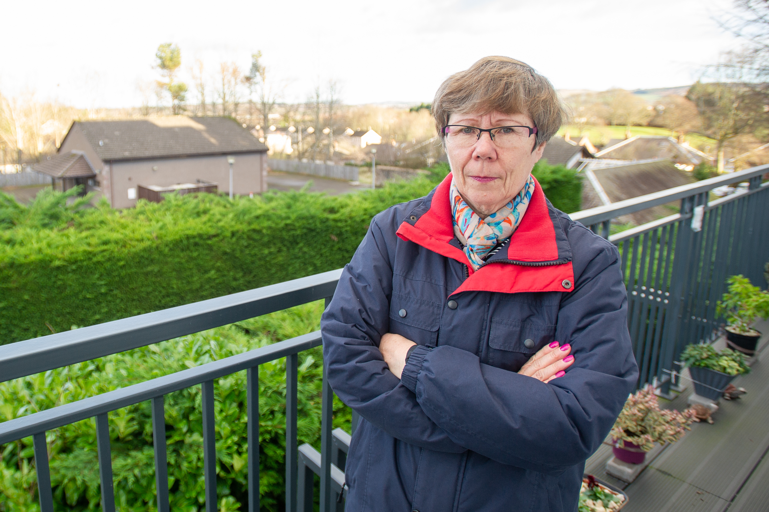 Morag McPherson on her balcony looking over the proposed area of the Gospel Hall which is to be developed.
