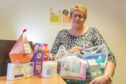 Gillian Davidson at the Forfar CAB office with some of the toiletries already donated.