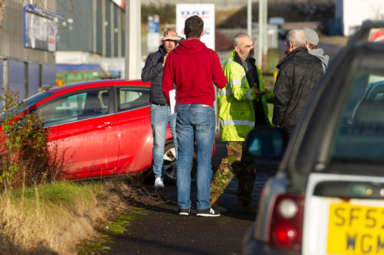 Workers gather outside the HES plant in Dundee