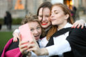 Magdalena Pribanva, Zofia Ossowska and Lisa Maria Frending celebrating after graduation.