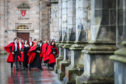 St Andrews University students in red gown at the chapel (St Salvator's Quad).
