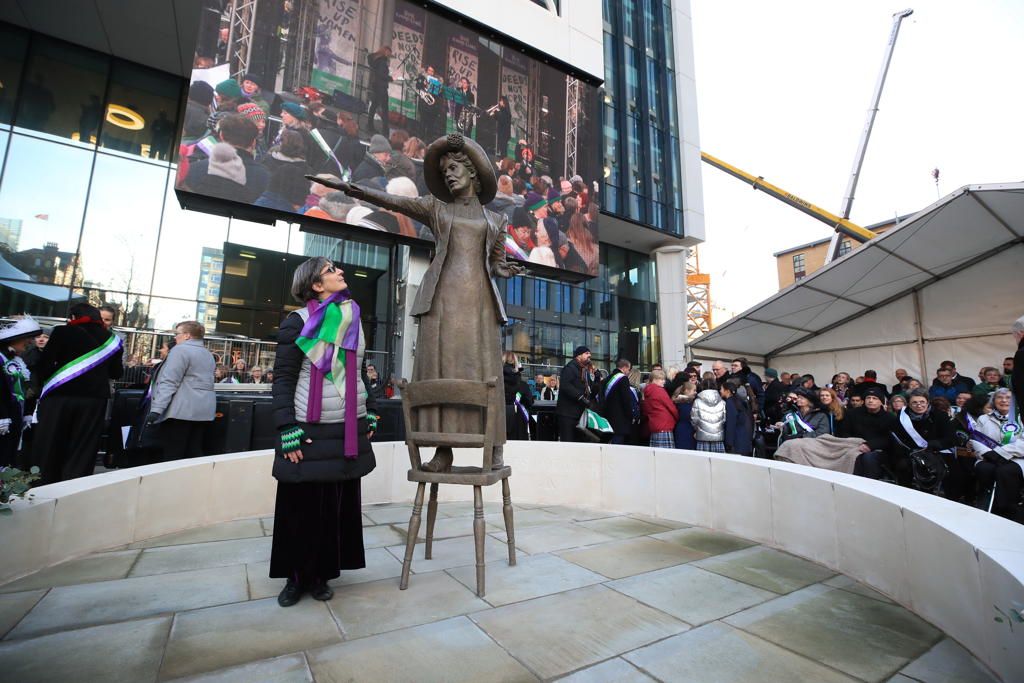 Helen Pankhurst, the great granddaughter of Emmeline Pankhurst, stands next to a statue of Emmeline, by sculptor Hazel Reeves following its unveiling.