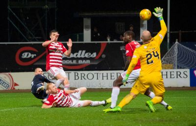 Kenny Miller opens the scoring for Dundee.