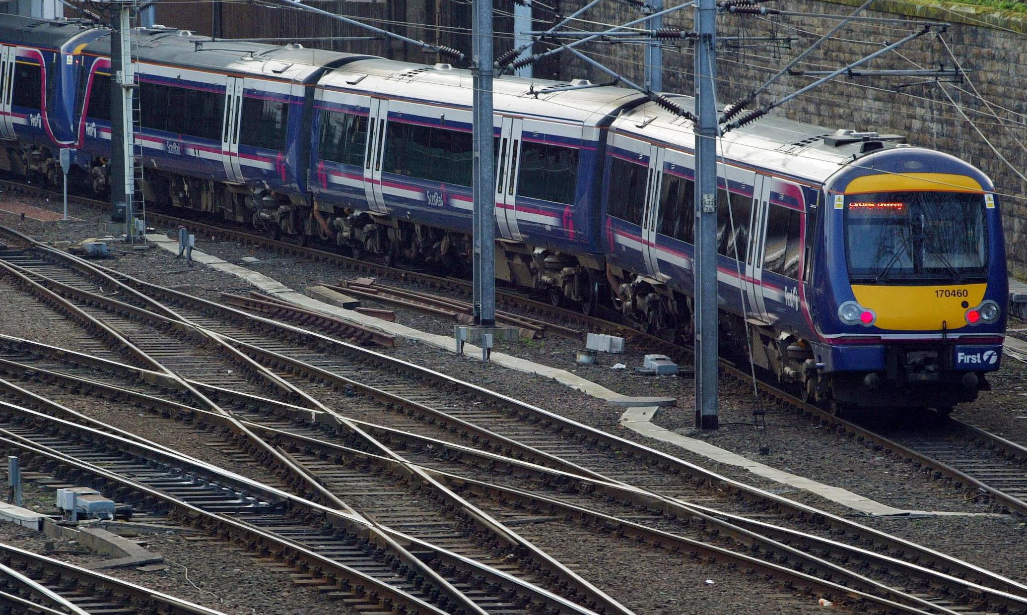A Scotrail train arrives at Edinburgh Waverley Station.