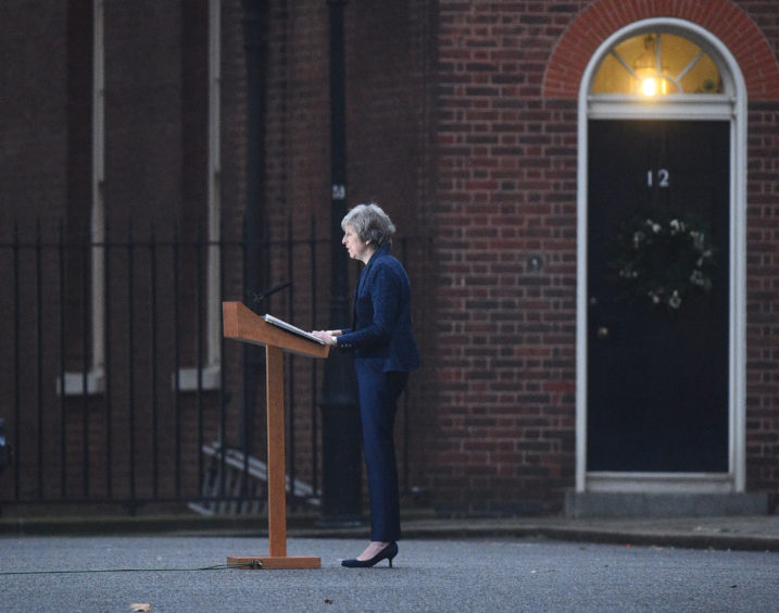 Prime Minister Theresa May making a statement outside 10 Downing Street, London, after the 1922 Committee announced that enough Conservative MPs have requested a vote of confidence in Mrs May to trigger a leadership contest.