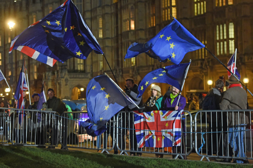 Protesters outside the Houses of Parliament in Westminster, London, ahead Conservative MPs holding a vote of confidence in Prime Minister Theresa May.