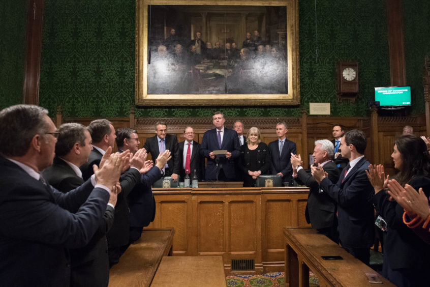 Sir Graham Brady (centre), chairman of the 1922 Committee, announces that Theresa May has survived an attempt by Tory MPs to oust her as party leader with a motion of no confidence at the Houses of Parliament in London.