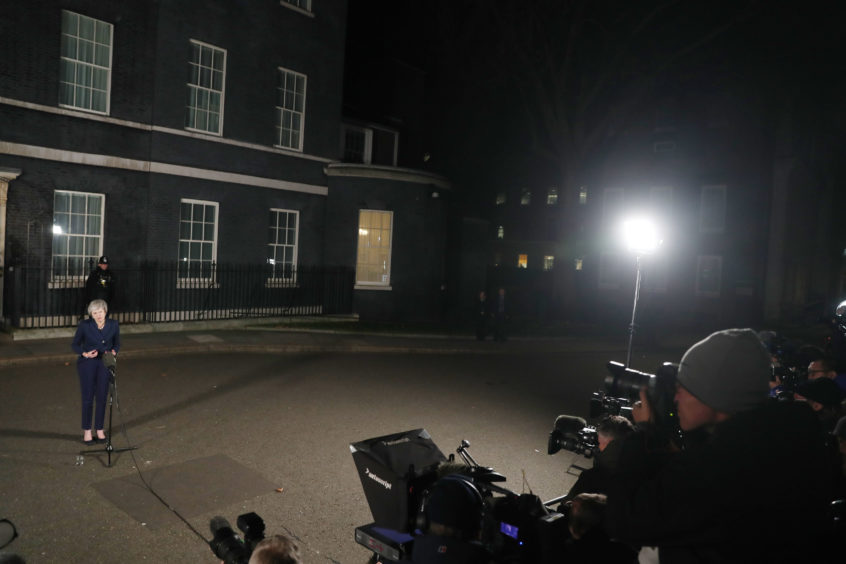 Still cutting a lonely figure PM Theresa May makes a statement in 10 Downing Street, London, after she survived an attempt by Tory MPs to oust her as party leader with a vote of no confidence.