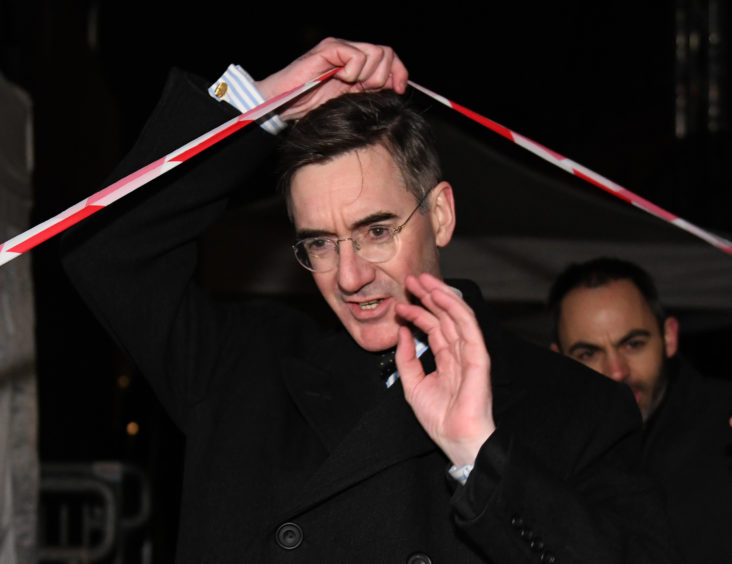 Conservative MP Jacob Rees-Mogg departs after speaking to the media outside the Houses of Parliament in Westminster, London, after Prime Minister Theresa May survived an attempt by Tory MPs to oust her with a vote of no confidence.
