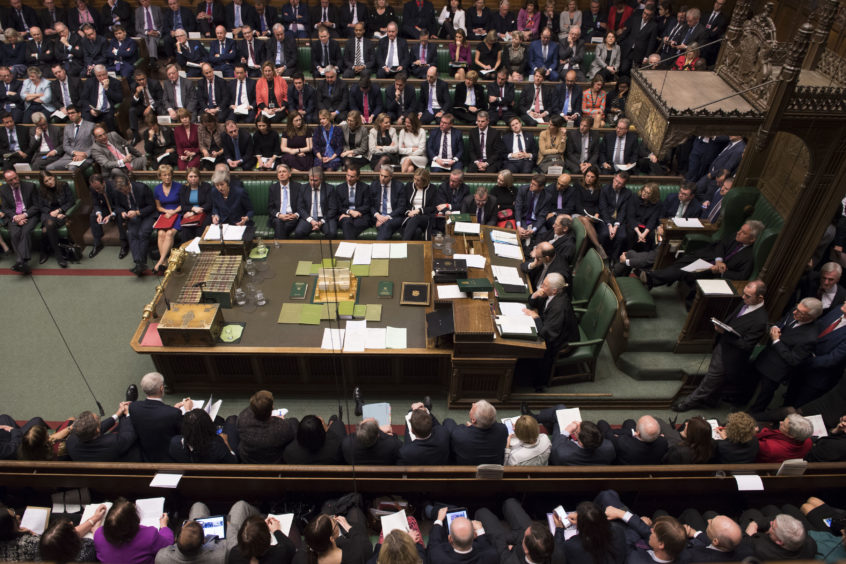 Prime Minister Theresa May during Prime Minister's Questions in the House of Commons, London.