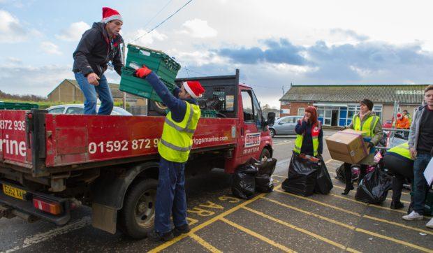 Volunteers help distribute food donated last year