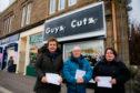 Councillor David Cheape with Angela Balfour, left, of Belles and Loula Makaronas of Guyz Cutz.