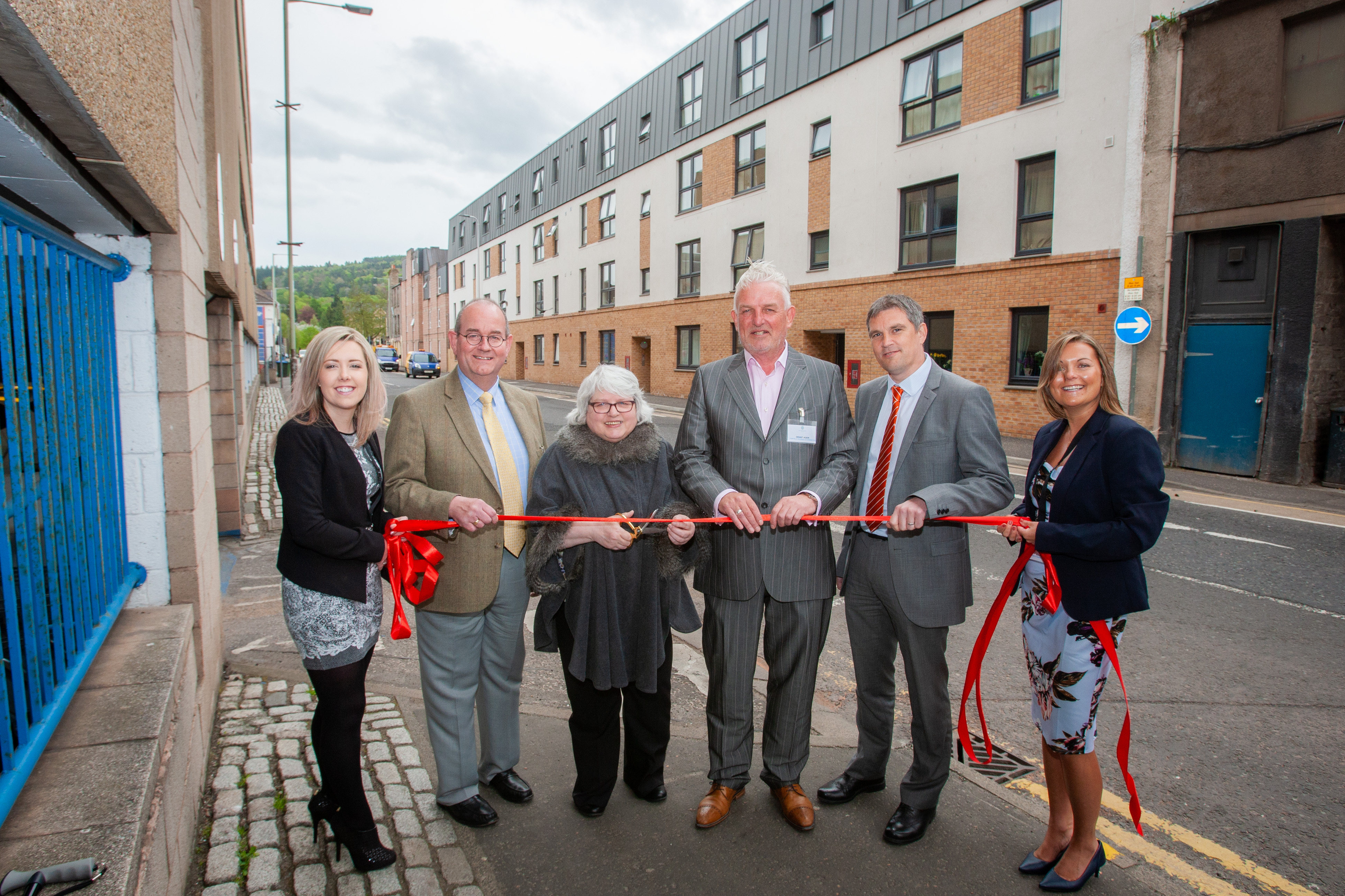 Fairfield's Canal Street development opened in May. From left: Stephanie Joss, corporate administrator, Fairfield, Councillor Bob Brawn, Rena Crighton, chairwoman of, Fairfield, Grant Ager, chief executive of  Fairfield, Stewart Shearer, managing director, Robertson Partnership Homes) and Sharon Bell, corporate manager of Fairfield.