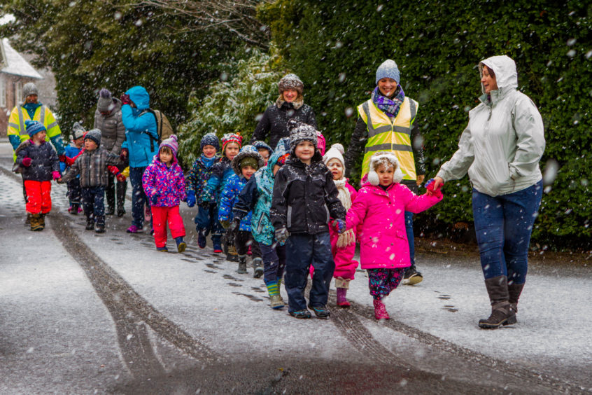 Children from Bridge of Earn Nursery didnt let the snow stop them getting to a music event at Moncreiffe Care Home. Steve MacDougall/DCT Media
